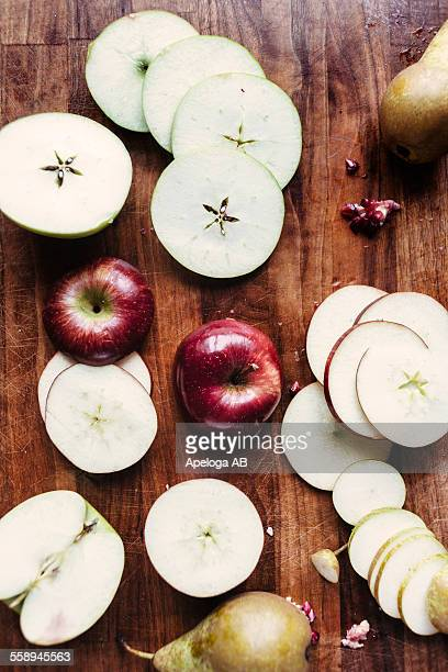 Directly above shot of apple and pear slices on chopping board