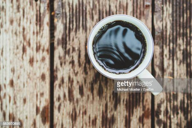 Directly Above Shot Of Black Coffee On Wet Table