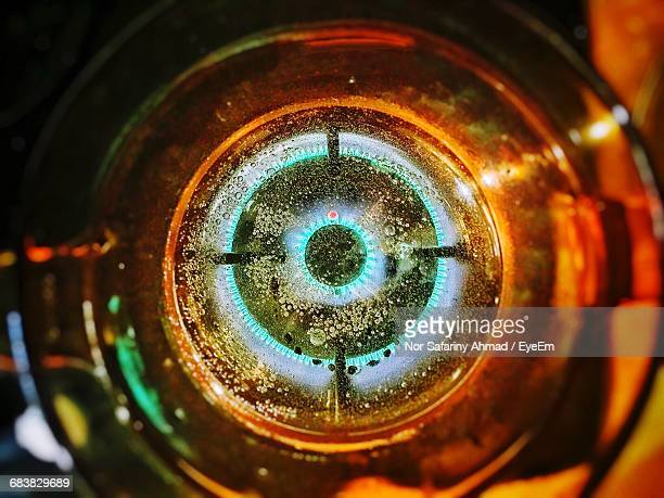 Directly Above Shot Of Boiling Water In Glass On Stove