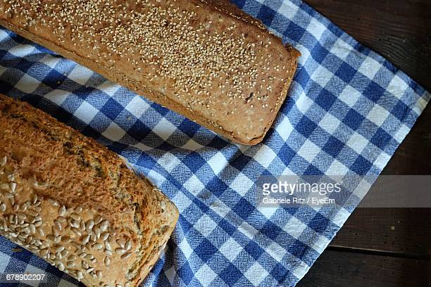 Directly Above Shot Of Bread With Napkin On Table