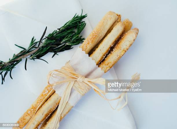 Directly Above Shot Of Breadsticks With Rosemary