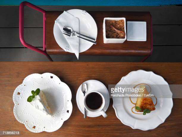 Directly Above Shot Of Cakes In Plate By Coffee Cup On Table In Hotel