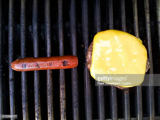 Directly Above Shot Of Cheeseburger And Hot Dog On Grill