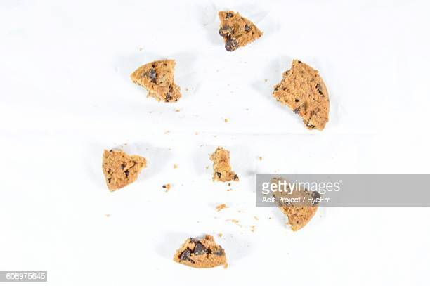 Directly Above Shot Of Chocolate Chip Cookie Pieces On White Background