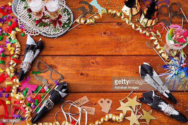Directly above shot of Christmas decorations on wooden table