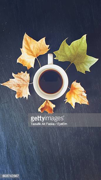 Directly Above Shot Of Coffee Cup Surrounded By Autumn Leaves On Table