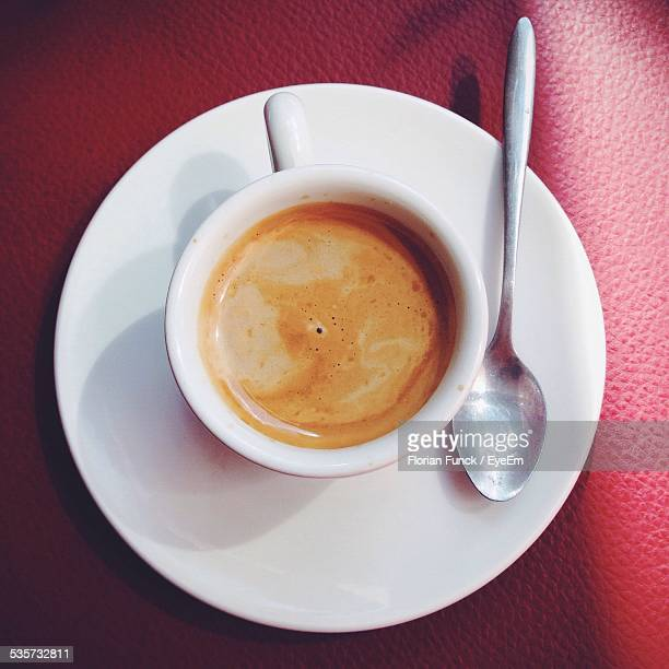 Directly Above Shot Of Coffee Cup With Saucer And Spoon On Table In Restaurant