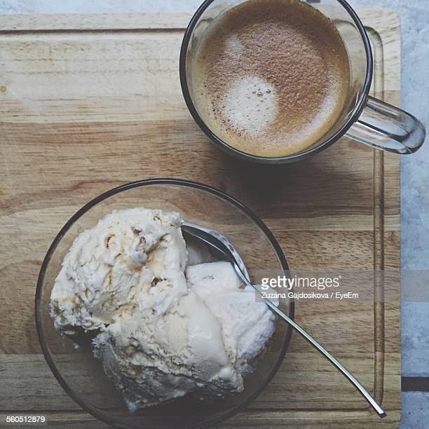Directly Above Shot Of Coffee Cup With Whipped Cream On Bowl