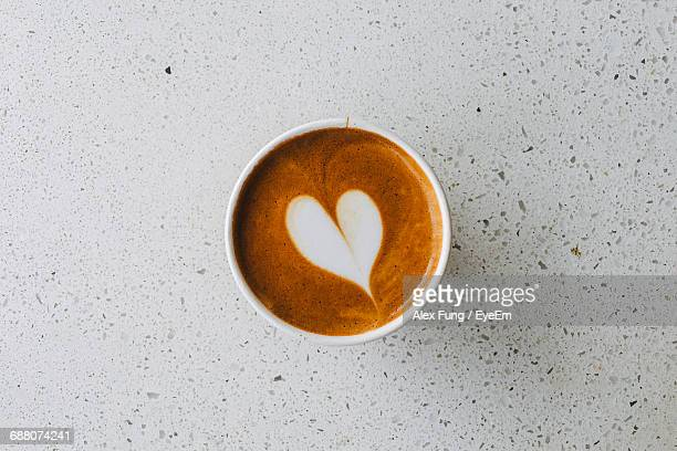 Directly Above Shot Of Coffee In Cup On Floor