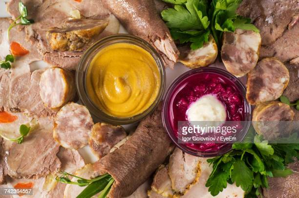 Directly Above Shot Of Cold Cuts With Mustard And Horseradish Sauce On Plate
