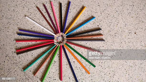 Directly Above Shot Of Colored Pencils Arranged On Floor