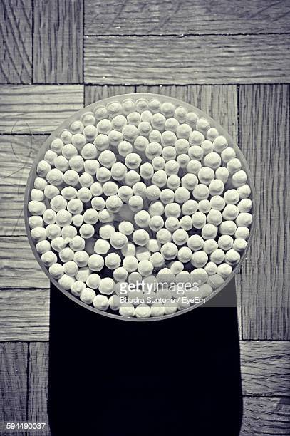 Directly Above Shot Of Cotton Swab In Container On Table