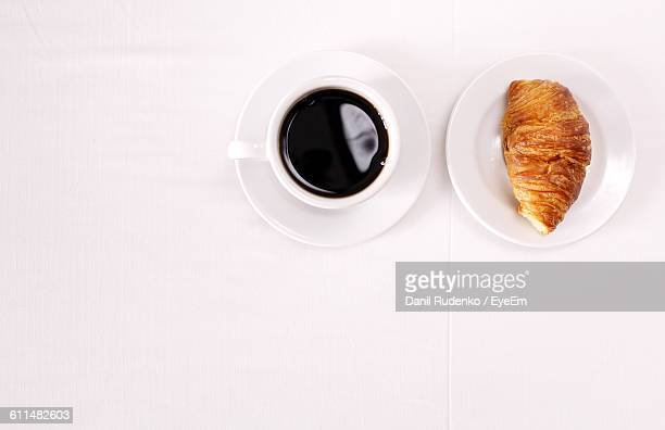 Directly Above Shot Of Croissant And Espresso On Table