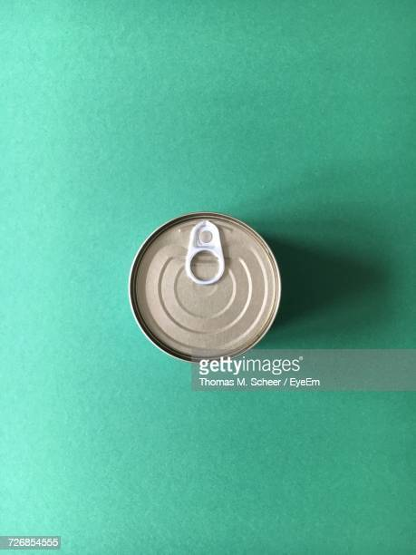 Directly Above Shot Of Drink Can On Green Background