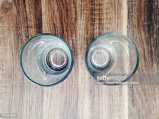 Directly Above Shot Of Drinking Glasses On Table At Home