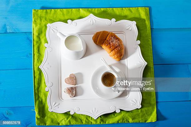 Directly Above Shot Of Espresso Served With Croissant And Milk On Table