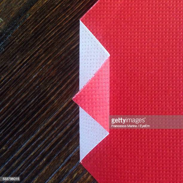 Directly Above Shot Of Folded Red Paper On Table