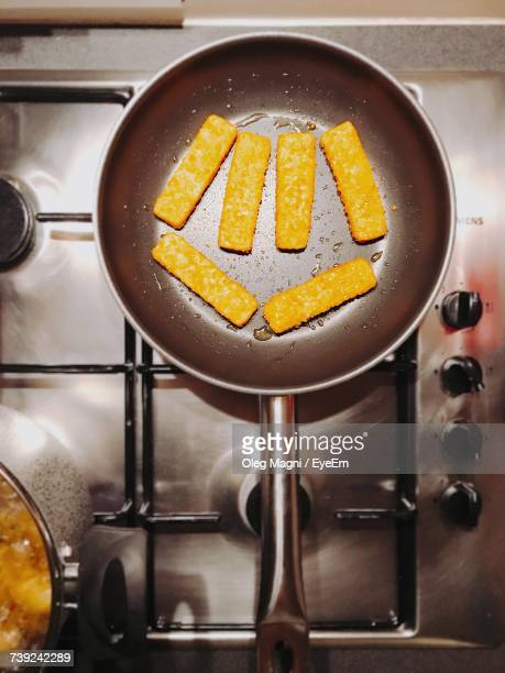 Directly Above Shot Of Food Cooking On Gas Stove Burner