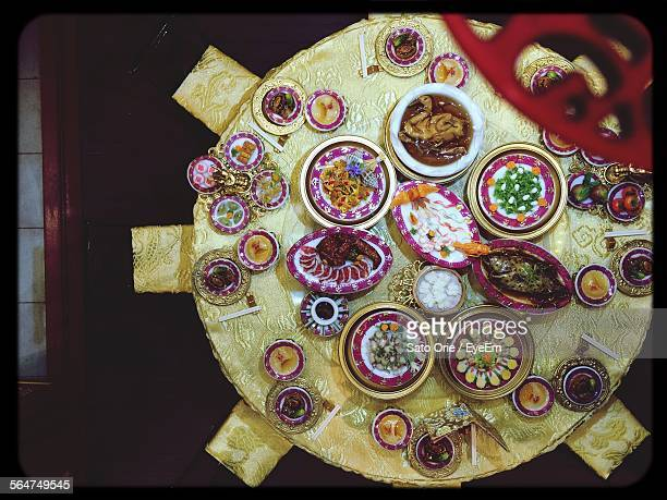 Directly Above Shot Of Foods On Decorated Dining Table