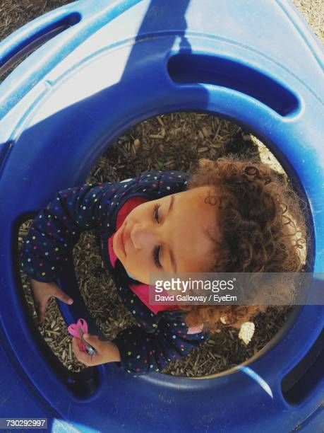 Directly Above Shot Of Girl Amidst Blue Baby Walker At Playground
