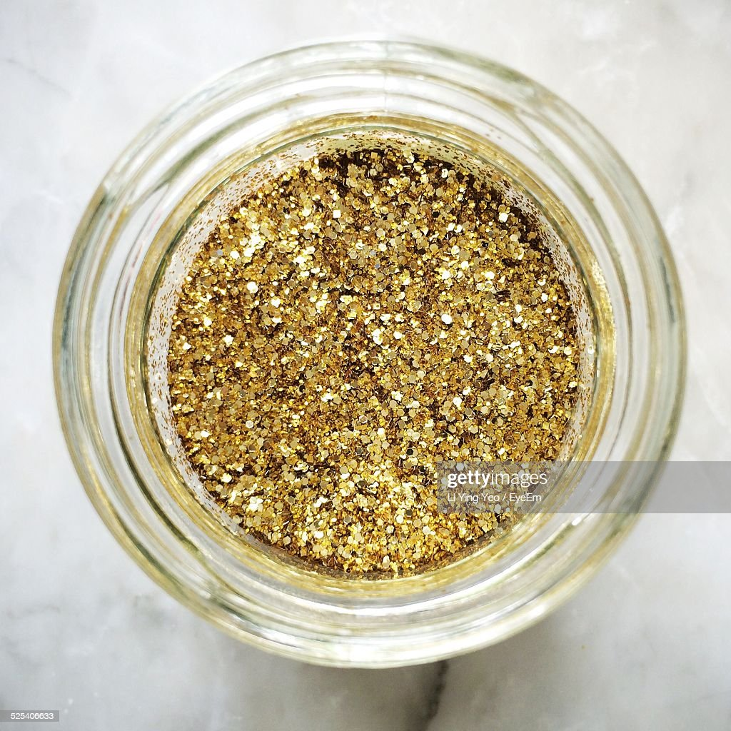 Directly Above Shot Of Gold Glitters In Glass