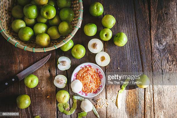 Directly Above Shot Of Granny Smith Apple And Knife With Basket On Table