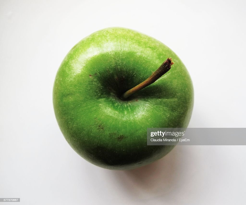 Directly Above Shot Of Green Apple On White Background