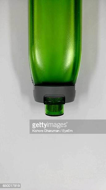 Directly Above Shot Of Green Water Bottle Against White Background