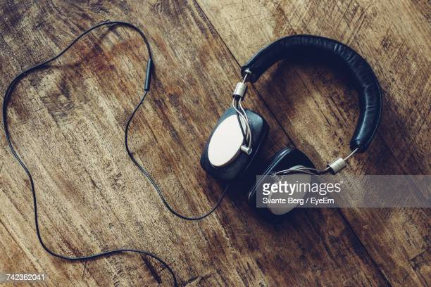 Directly Above Shot Of Headphones On Wooden Table