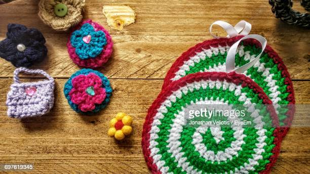 Directly Above Shot Of Knitted Handicrafts On Wooden Table