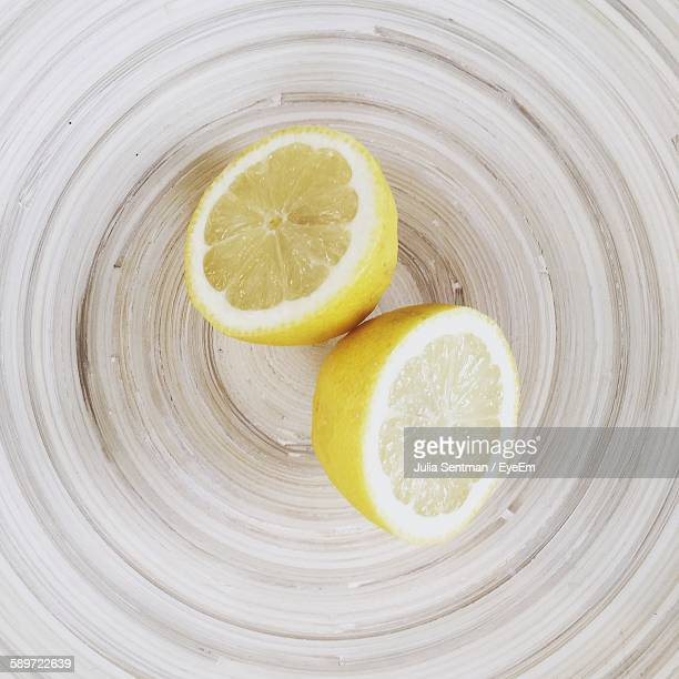 Directly Above Shot Of Lemon Slices On Textured Cutting Board