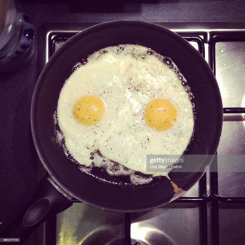 Directly Above Shot Of Making Egg In Frying Pan