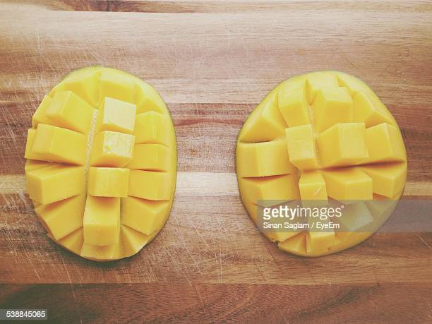 Directly Above Shot Of Mango Slices On Wooden Table