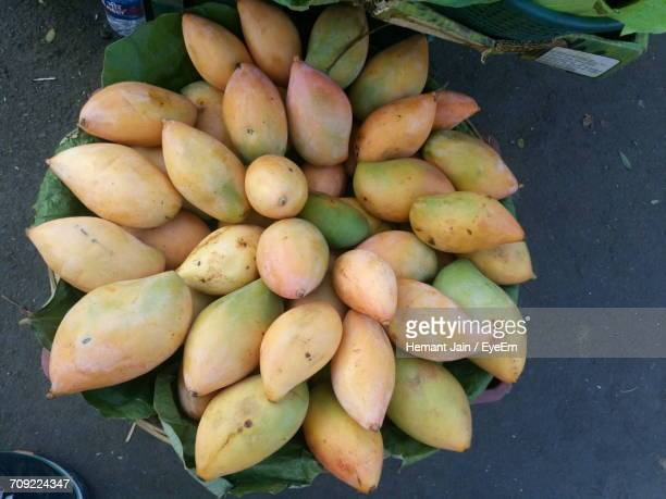 Directly Above Shot Of Mangoes In Basket On Street At Market For Sale