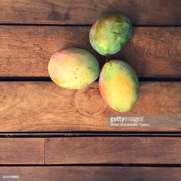 Directly Above Shot Of Mangoes On Wooden Table