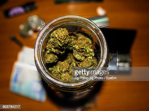 Directly Above Shot Of Marijuana In Jar On Table