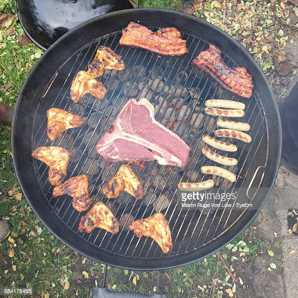 Directly Above Shot Of Meat And Sausages Grilling On Barbecue