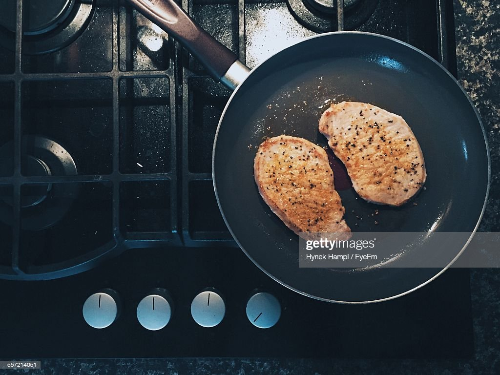 Directly Above Shot Of Meat Cooking In Pan
