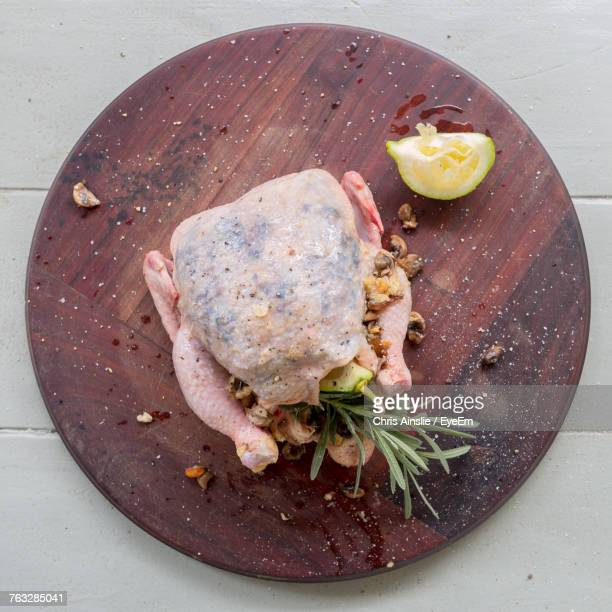 Directly Above Shot Of Meat On Wooden Plate On Table