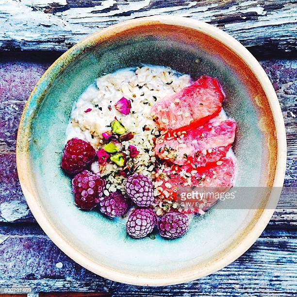 Directly Above Shot Of Oats And Yogurt With Berries In Bowl