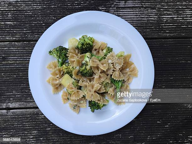 Directly Above Shot Of Pasta Served In Plate On Wooden Table