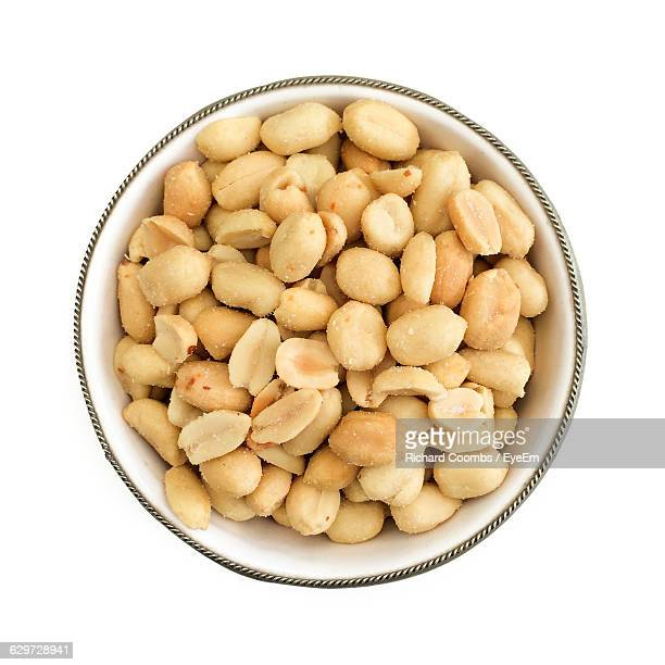 Directly Above Shot Of Peanuts In Bowl On White Background