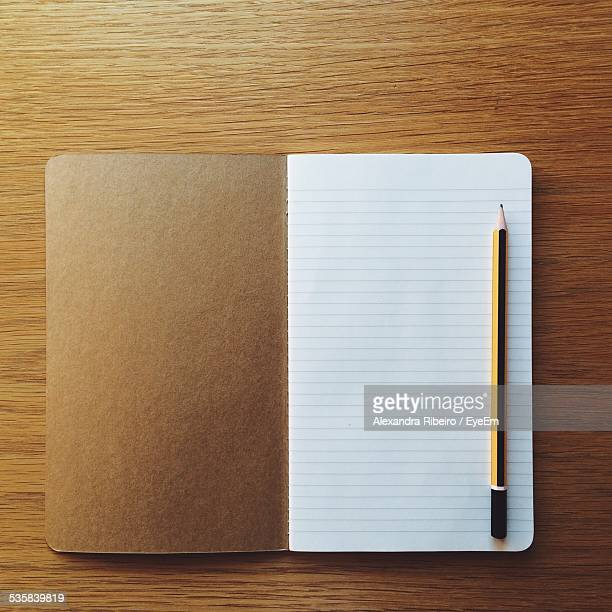 Directly Above Shot Of Pencil And Notebook On Table
