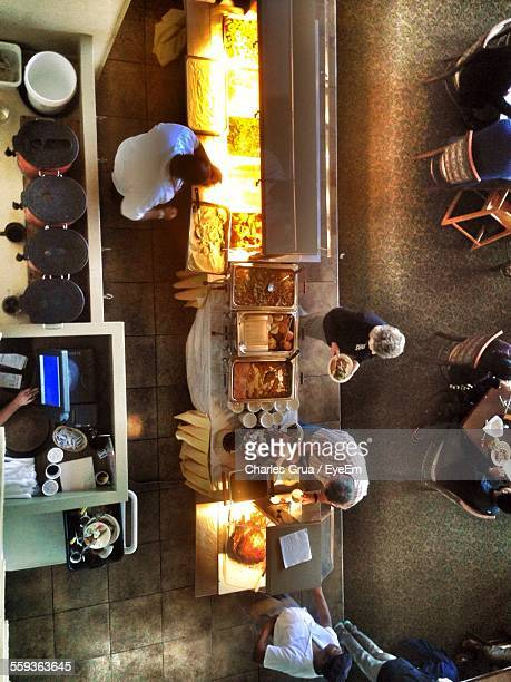 Directly Above Shot Of People In Restaurant