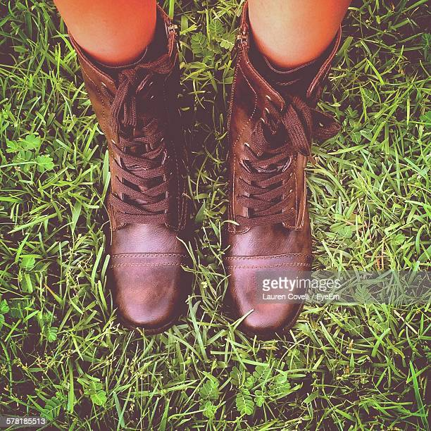 Directly Above Shot Of Person Wearing Combat Boots On Grass