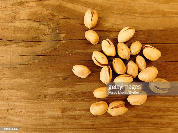 Directly Above Shot Of Pistachios On Wooden Table