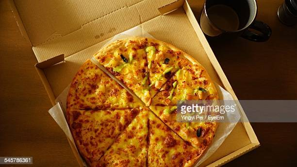 Directly Above Shot Of Pizza And Tea Cup On Table