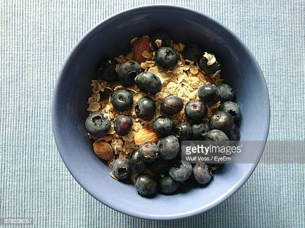 Directly Above Shot Of Porridge With Blueberries On Table