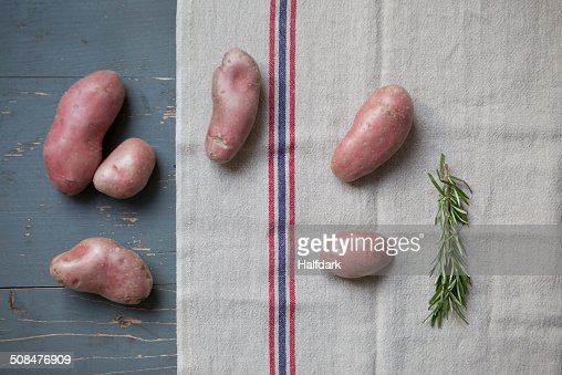 Directly above shot of potatoes with rosemary on table