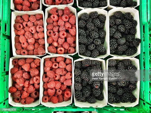 Directly Above Shot Of Raspberries And Blackberries In Green Crate